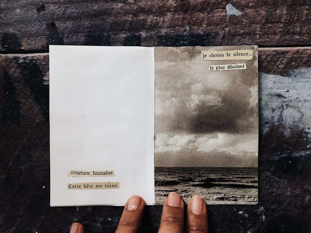 A small zine depicting clouds and strormy skies with cut out poetry
