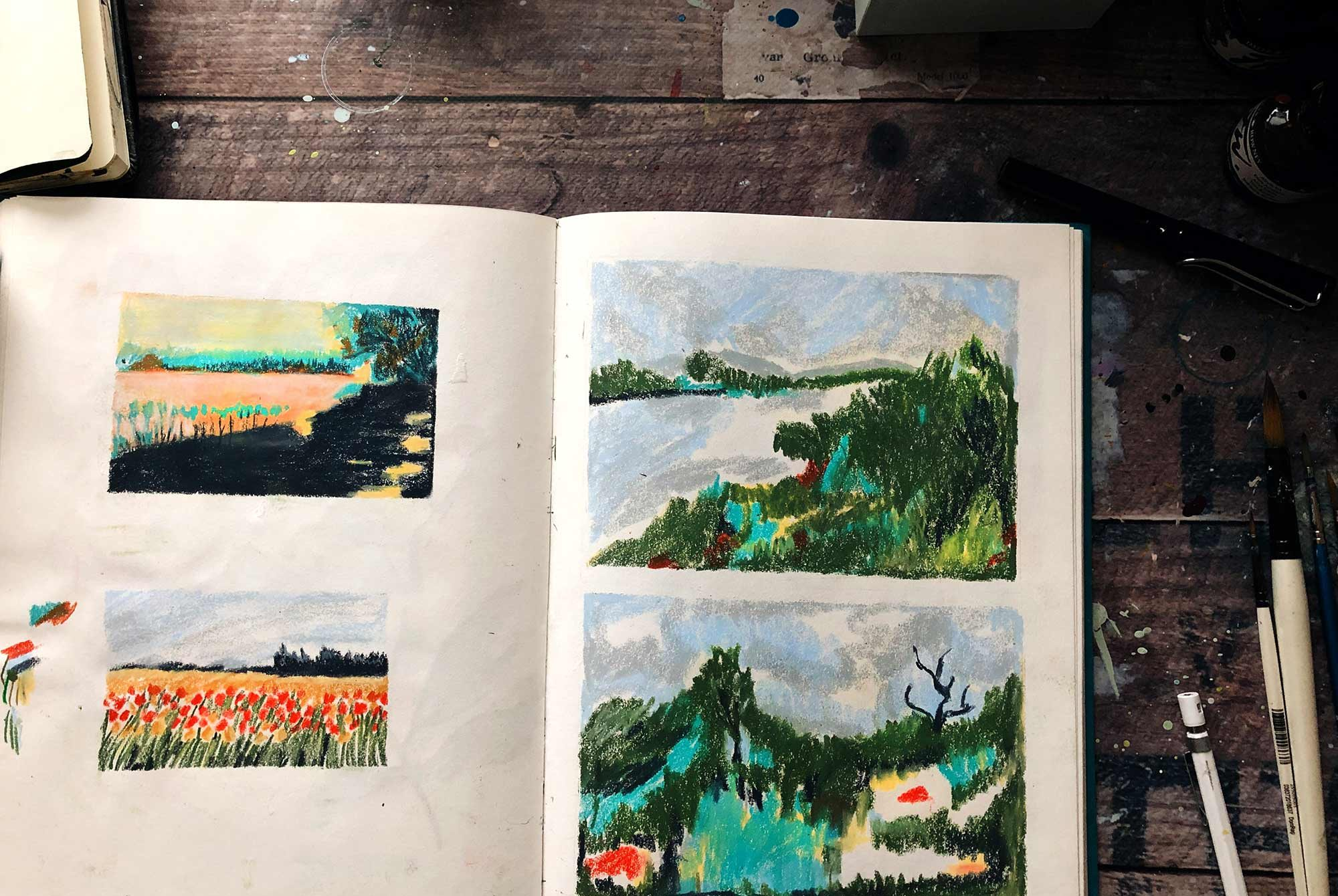 large sketchbook depicting different landscapes in Wax Pastels